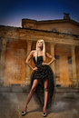 Portrait of pretty woman standing in black elegant dress outdoors Stock Images