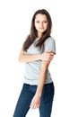 Portrait of pretty young brunette woman wearing blue jeans and gray t shirt isolated on white background Royalty Free Stock Image