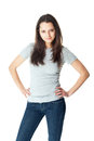 Portrait of pretty young brunette woman wearing blue jeans and gray t shirt isolated on white background Stock Photography