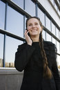 Portrait of pretty young business woman near building Royalty Free Stock Image