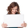 Portrait of a pretty young businesswoman holding a laptop on a white background Stock Photos