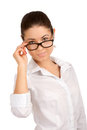 Portrait pretty young businesswoman looking over glasses Royalty Free Stock Photos