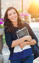 Portrait of Pretty Young Female Student Carrying Books on School Royalty Free Stock Photo