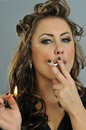 Portrait of pretty young smoking woman Stock Photos