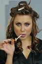Portrait of pretty young smoking woman Stock Images