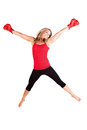Portrait of pretty young woman doing boxing exercise beautiful in a red tanktop and gloves kickboxing Royalty Free Stock Photos