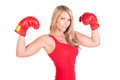 Portrait of pretty young woman doing boxing exercise beautiful in a red tanktop and gloves kickboxing Stock Image