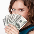 Portrait of pretty young woman holding a fan of dollar bills on white background Stock Photography