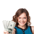 Portrait of pretty young woman holding a fan of dollar bills on white background Royalty Free Stock Photography