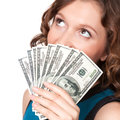 Portrait of pretty young woman holding a fan of dollar bills on white background Royalty Free Stock Photo