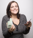 Portrait of pretty young woman with money isolated on white background Stock Photo