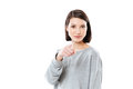 Portrait of a pretty young woman pointing finger at camera Royalty Free Stock Photo
