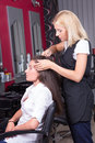 Portrait of professional hairdresser at work in beauty salon female Royalty Free Stock Image