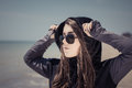 Portrait in profile of a teenage girl in sunglasses Royalty Free Stock Photo