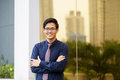 Portrait of proud and confident chinese office worker businessman standing with arms crossed near building in panama reflections Royalty Free Stock Photo