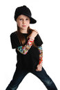 Portrait of a punk rock young girl with hat cute preschool age isolated on white background wearing tattoo clothes and star Royalty Free Stock Images