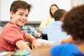 Portrait of pupil in class sitting down smiling to camera Royalty Free Stock Photography