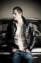Portrait of a rebel type guy in classic leather jacket Stock Photo