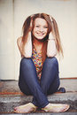 Portrait of red hair girl outdoor sitting on stairs smiling Royalty Free Stock Photo
