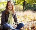 Portrait of red-haired girl in the autumn park Stock Image