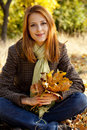 Portrait of red-haired girl in the autumn park Royalty Free Stock Photography
