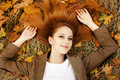 Portrait of red-haired girl in the autumn park. Royalty Free Stock Photography