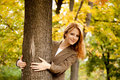 Portrait of red-haired girl in the autumn park. Royalty Free Stock Images