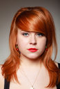 Portrait redhaired girl young woman with cherry earing on gray of creative fruit studio shot fashion and accessories Stock Photo