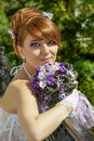 Portrait redhead charming bride of a beautiful with big eyes on a sunny day Stock Photography
