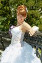 Portrait redhead charming bride of a beautiful with big eyes on a sunny day Royalty Free Stock Photo