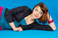 Portrait redhead girl on a blue background Stock Image