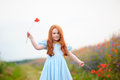 Portrait of a redhead little girl outdoors. beautiful stylish ro Royalty Free Stock Photo