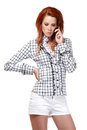 Portrait of a redhead woman making a call Stock Photo