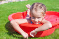 Portrait of relaxing charming little girl enjoying her vacation in small pool this image has attached release Royalty Free Stock Photo