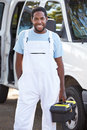 Portrait of repairman with van smiling to camera Stock Photos