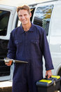 Portrait of repairman with van smiling to camera Royalty Free Stock Image