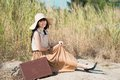 Portrait retro girl suitcase outdoors Royalty Free Stock Photo