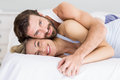 Portrait of romantic couple embracing on bed Royalty Free Stock Photo