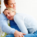 Portrait of a romantic couple hugging at home Stock Photography