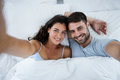 Portrait of romantic couple sleeping on bed Royalty Free Stock Photo