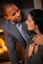 Portrait of romantic mixed couple race at home smiling Royalty Free Stock Images