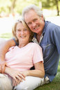 Portrait Of Romantic Senior Couple In Park Stock Photography