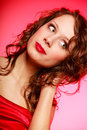 Portrait romantic woman girl in red dress on pink valentines day of curly young studio shot Stock Photo