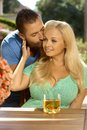 Portrait of romantic young couple kissing at summer garden outdoors attractive busty blonde women with cleavage Royalty Free Stock Photo