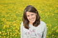 Portrait of romantic young woman with yellow flowers beautiful brunette on the meadow smiling the are alpine sonchus tenerrimus Stock Images