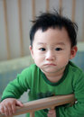 Portrait sad asian boy crib Stock Images