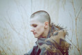 Portrait of sad beautiful Caucasian white young bald girl woman with shaved hair head in leather jacket and scarf Royalty Free Stock Photo