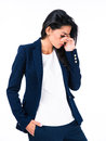Portrait of a sad businesswoman standing over white background Royalty Free Stock Images
