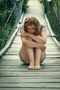 Portrait of a sad girl on the bridge young woman Stock Photo