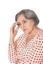 Portrait of a sad senior woman isolated on white Stock Photography